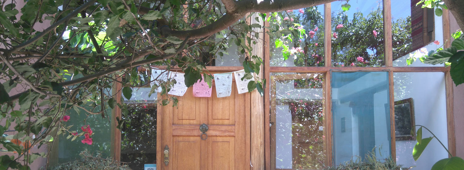 Door With Prayer Flags - Andean Spirit Lodge